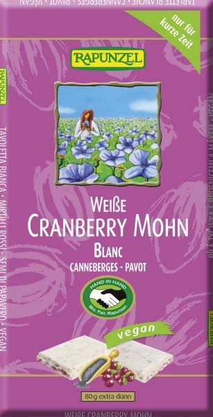 Weiße Tafel mit Cranberries und Mohn